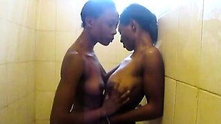 Lovely African babes go into a bathroom and immediately get