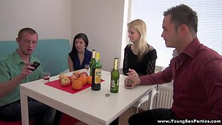 Naughty teens are fucked by two guys in a foursome
