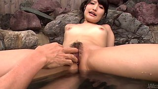 Freaky stud rubs clit of his leggy Asian chick with nice vibrator