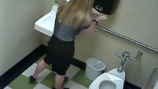 Blonde peeing in public toilet