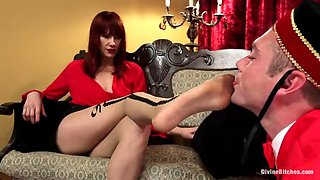 redhead mistress gives her slave a footjob