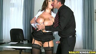Perverted boss fucks naughty and busty secretary on the table